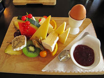 Breakfast on wooden plate Stock Image