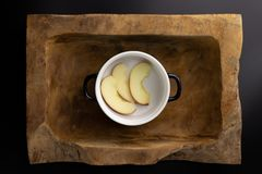 Breakfast on a wooden rectangular bowl with a black and white pot. stock photo