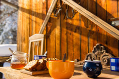 Breakfast wooden table outside winter snow cottage Stock Photos