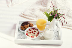 Breakfast on a wooden tray in bed in the morning Royalty Free Stock Image