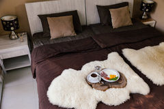 Breakfast on a wooden tray in hotel bedroom Stock Image