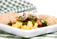 Breakfast Wrap. Delicious breakfast wrap of egg, green pepper, ham and cheeseon a whole wheat wrap Stock Image