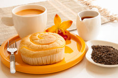 Breakfast wth bread and cup of milk tea. Stock Image
