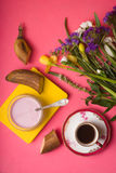 Breakfast with yoghurt, coffee and a bouquet of flowers Stock Photography