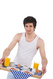 Breakfast - young man holding tray with breakfast Royalty Free Stock Images
