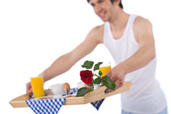 Breakfast - young man holding tray with rose Stock Photo