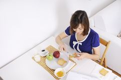 Breakfast of young woman Stock Images