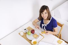 Breakfast of young woman Stock Photo