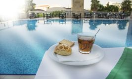Breakfest by the pool in the summer resort royalty free stock photos