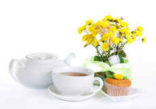 Breakfest with tea, cake and yellow flowers Royalty Free Stock Photography