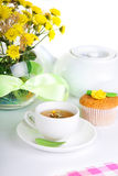 Breakfest with tea, cake and yellow flowers Stock Image