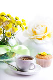 Breakfest with tea, cake and yellow flowers Stock Photography