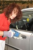 Breaking. The Elderly Woman Forces the Lock of the Car, Using the Hand Drill Royalty Free Stock Photography