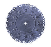 Breaking apart of the old clock face. On white background Royalty Free Stock Images