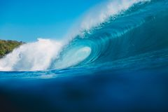 Breaking barrel wave in ocean. Blue wave and sky in Bali. Breaking barrel wave in ocean. Blue wave in Bali Royalty Free Stock Photos