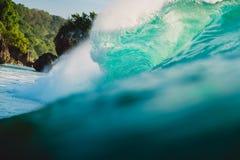 Breaking barrel wave in ocean. Blue wave in Bali, Padang Padang. Breaking barrel wave in ocean. Blue wave in Bali Stock Photo