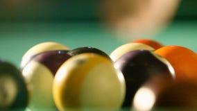 Breaking billiard balls on pool table stock video footage