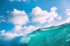 Breaking blue wave with sun light and sky with clouds. Breaking blue wave with sun light and sky with cloud royalty free stock photography