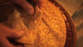 Breaking bread above stock footage