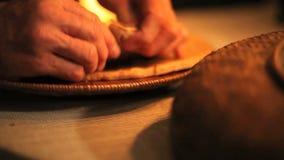 Breaking bread pan shot stock footage
