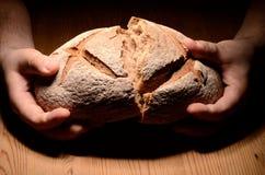 Breaking bread Stock Images