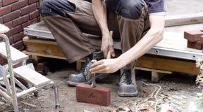 Breaking bricks stock image