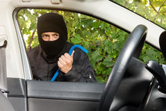 Breaking in a car forcefully Royalty Free Stock Photo
