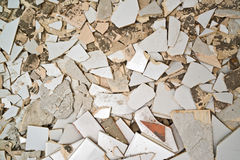 Breaking ceramic tiles Royalty Free Stock Image