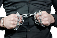 Breaking a chain. Man hands breaking a chain Stock Images