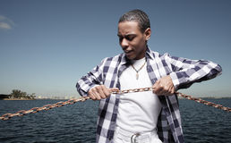 Breaking the chains. Young teenager breaking the chains Royalty Free Stock Photos