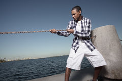 Breaking the chains. Young teenager breaking the chains Stock Image