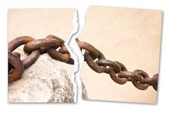 Breaking the chains - concept image with a ripped photo of an old rusty metal chain.  royalty free stock images