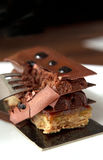 Breaking chocolate temptation. Breacking floors of chocolate dessert Stock Images