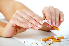 Breaking the cigarette Stock Photography