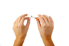 Breaking the cigarette in half Royalty Free Stock Photos