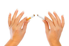 Breaking a cigarette Royalty Free Stock Photos