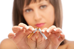 Breaking a cigarette Stock Photo