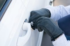 Breaking the door lock of the car, for further theft, close-up royalty free stock photography