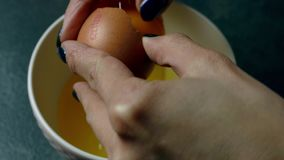 Breaking the egg stock footage