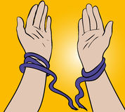 Breaking free. Hands breaking free from tied ropes Stock Photography