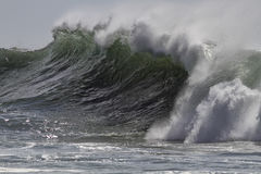 Breaking green wave Stock Photo