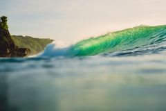 Breaking green wave in ocean. Perfect wave and evening light. Breaking green wave in ocean. Perfect wave and evening Stock Photos