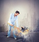 Breaking a guitar royalty free stock photo