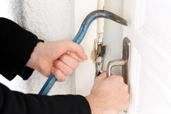 Breaking into a house. Burglar breaking into a house, housebreaker Royalty Free Stock Photos