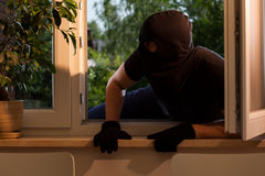 Breaking into the house. By the window Stock Image
