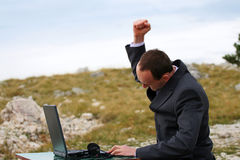 Breaking the laptop. In nature royalty free stock image