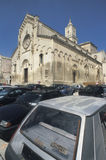 Breaking the law: illegal parking on a historical square in Matera, Italy Stock Image