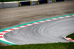 Breaking lines in a corner at a raceway royalty free stock photo
