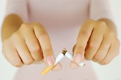 Breaking my cigarette to stop the addiction Stock Photos