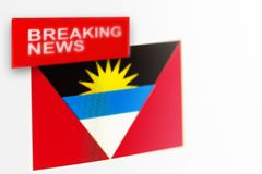 Breaking news, Antigua and Barbuda country`s flag and the inscription news stock photos